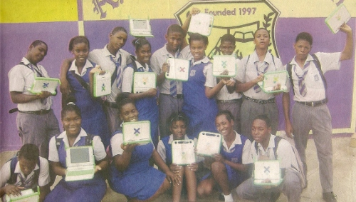 Kids in Jamaica holding thier OLPC laptop computer
